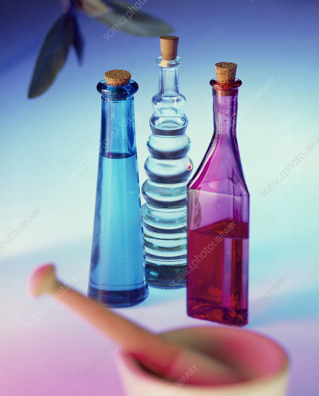 Aromatic oil bottles with pestle & mortar and sage