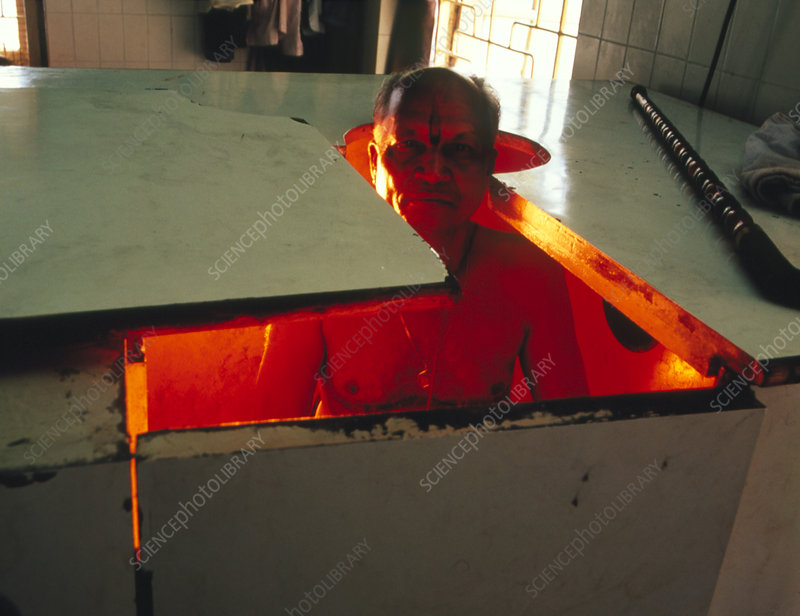 Man in steam bath as part of Ayurvedic therapy