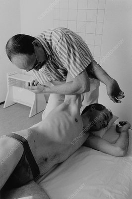 Therapist performing Rolfing massage therapy