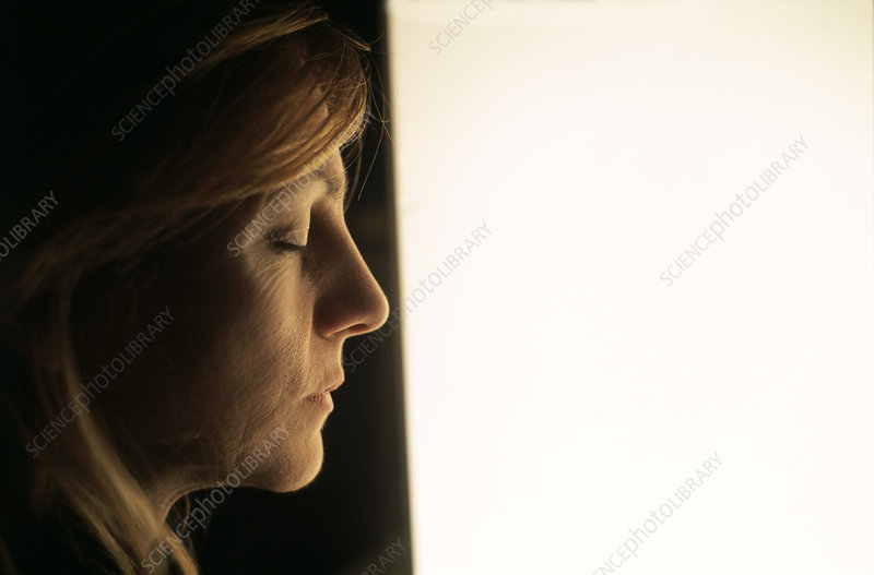 Woman undergoing phototherapy treatment