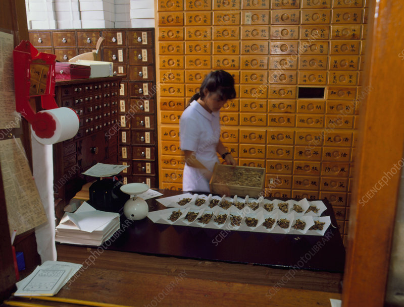 Dispensing Chinese herbal medicine at a Pharmacy