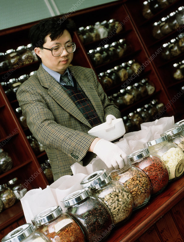 Herbalist in a Chinese herbal medicine pharmacy