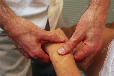 Chiropractic adjustment of the bones of the wrist.