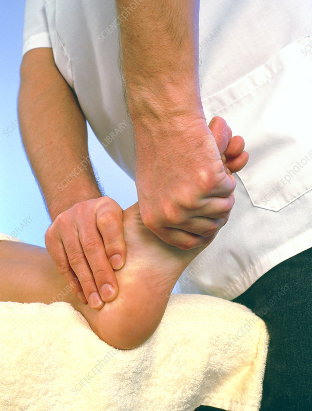 Osteopath treating the foot of a patient