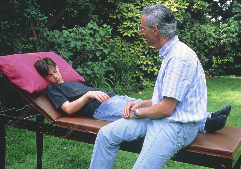 Hypnotherapist with young male subject