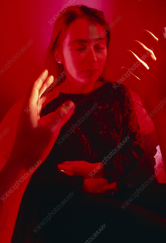 Woman being hypnotised by waving hands