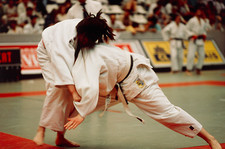 Two women fighting using the martial art of judo