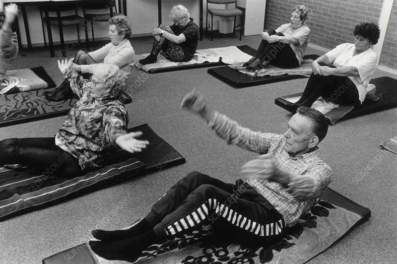 View of elderly people during a yoga class