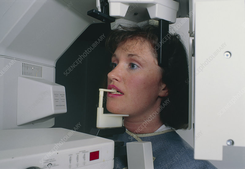 Woman undergoing a panoramic dental X-ray