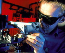 Technician placing tooth under a Terahertz imager