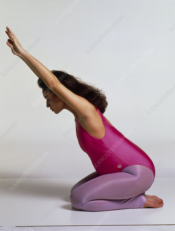 Prenatal exercise: pregnant woman sits stretching