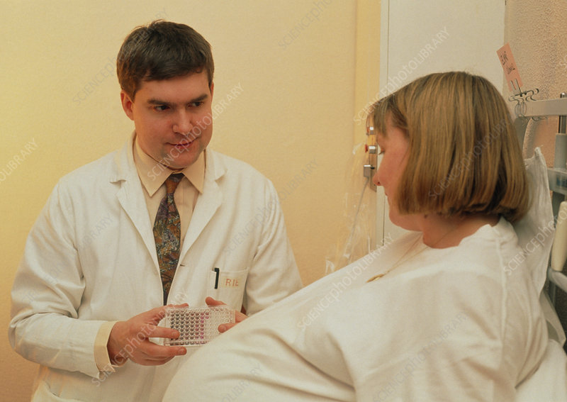 Down's inhibin test: doctor with pregnant woman
