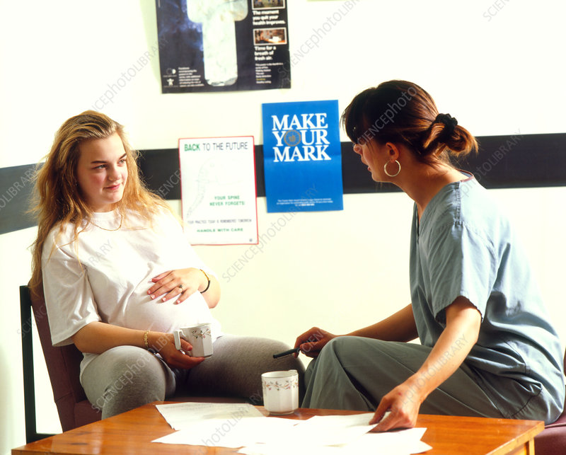 Midwife with pregnant woman in an antenatal clinic