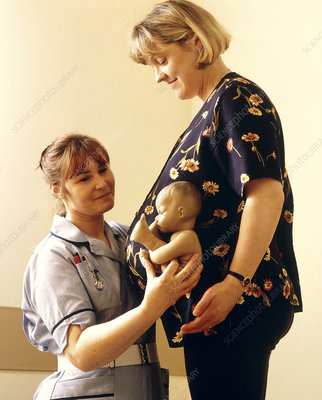 Midwife with pregnant woman in an antenatal class