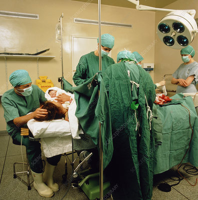 Mum holding her baby after a caesarean section
