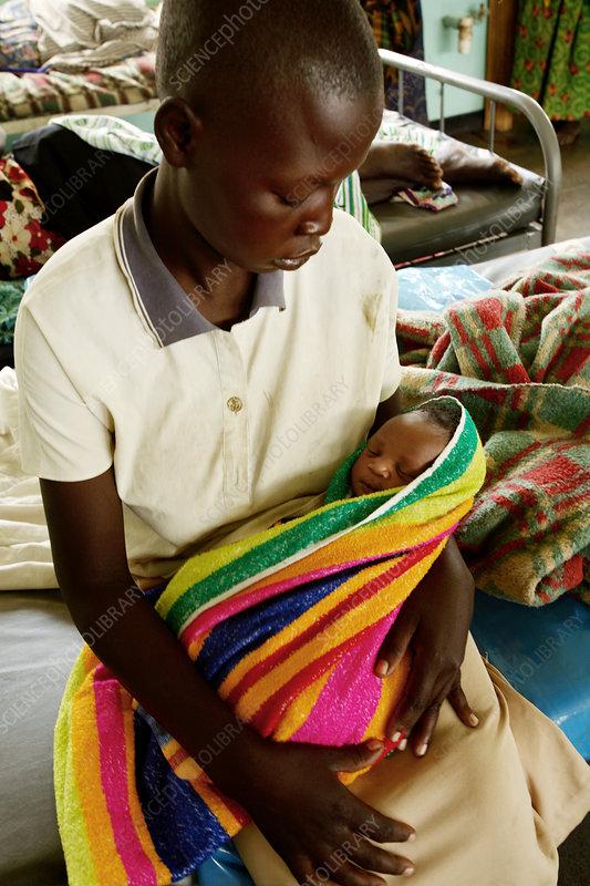 Child and newborn baby