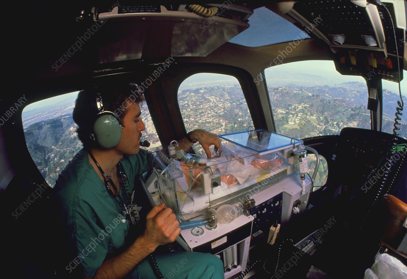 Newborn baby in an incubator in an air ambulance