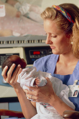 Nurse and baby in intensive care unit