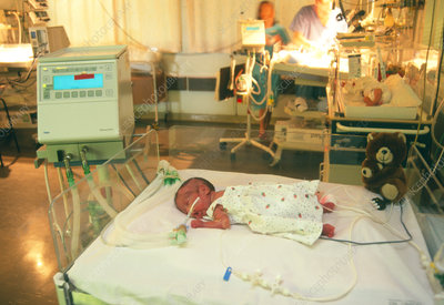 Premature baby on monitor in intensive care unit