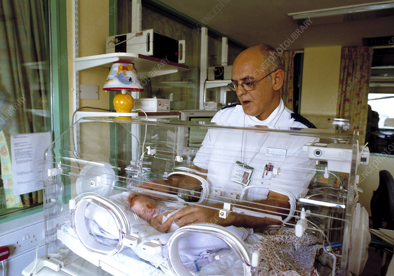 Premature baby and nurse