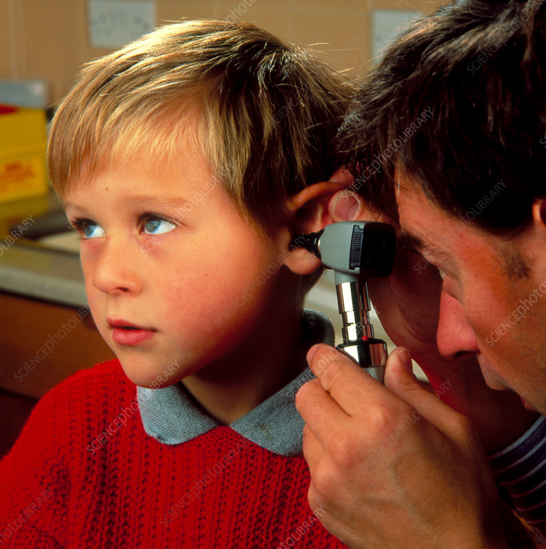 Doctor with otoscope to check child's ear