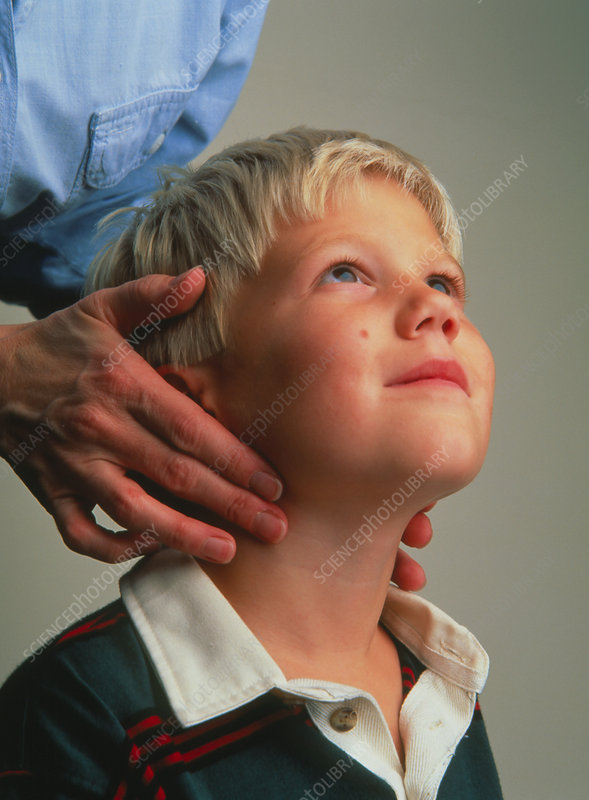 Doctor examines child's neck for swollen glands