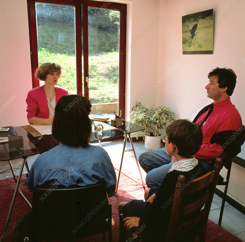 Young boy & parents in consultation with GP doctor