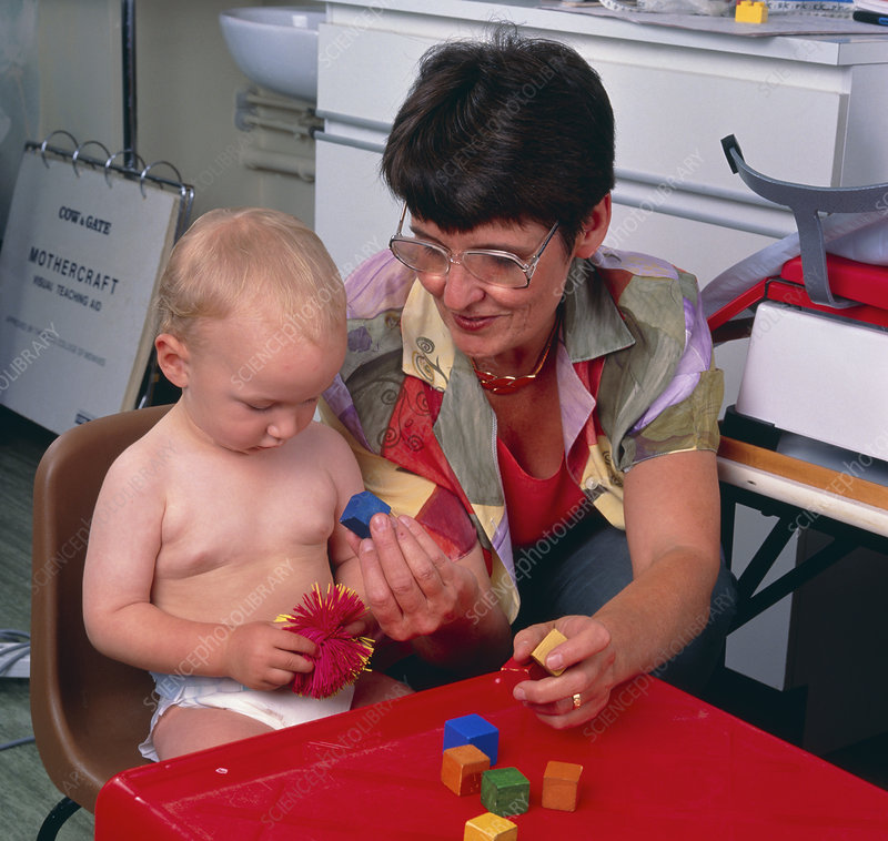Paediatrician measuring baby's cognitive skills