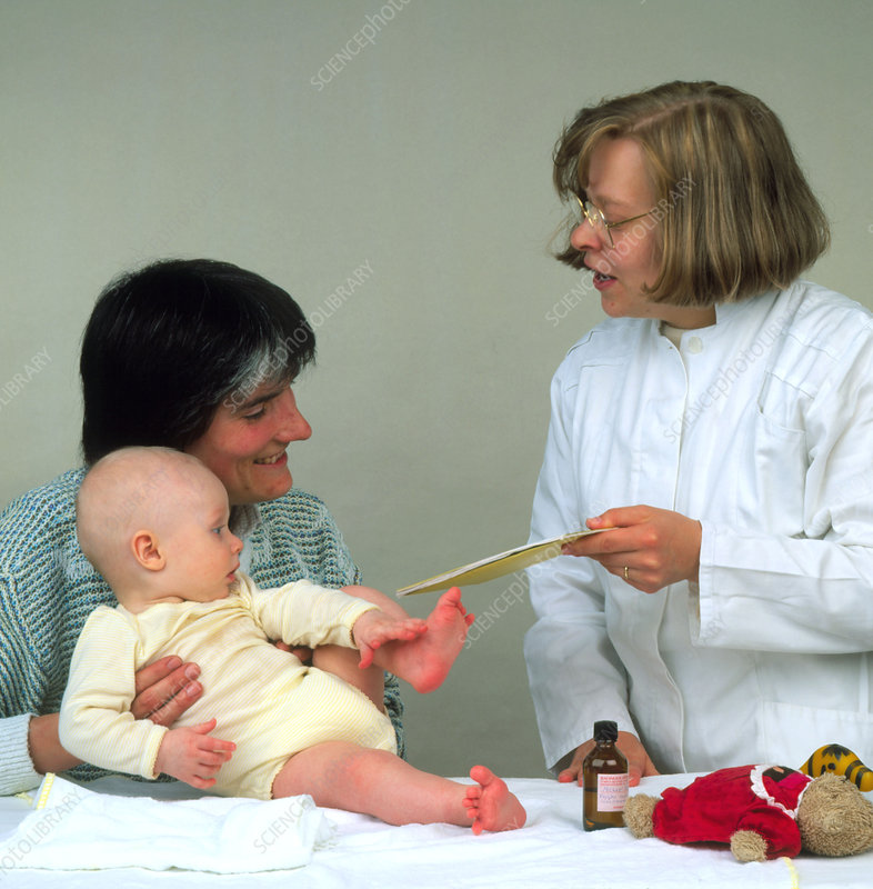 A mother and baby attend a paediatric examination