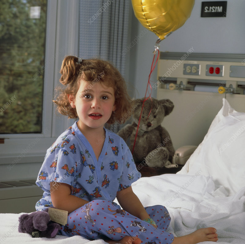 Young girl on a bed in a paediatric ward