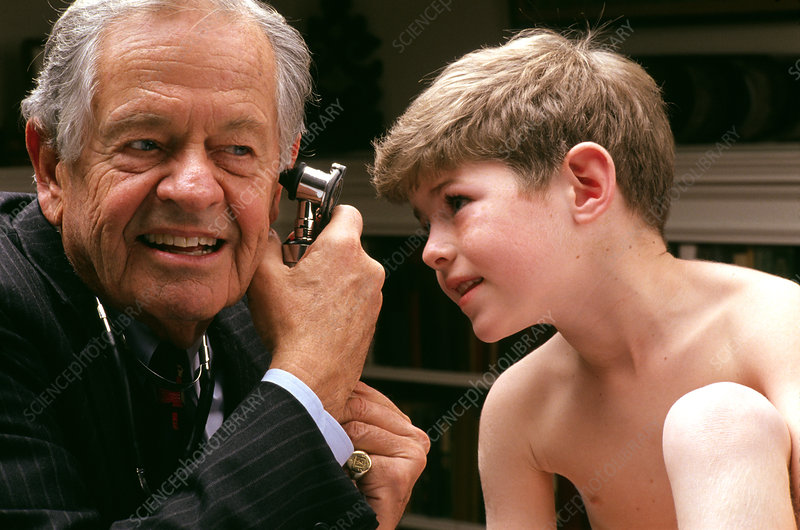 Paediatrician Dr Brazelton with boy and otoscope