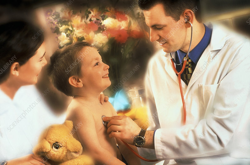 Doctor examines a boy's chest with a stethoscope