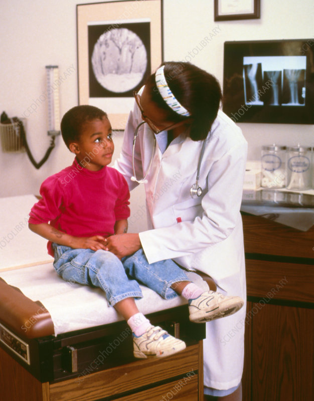 Doctor examining a young girl during consultation
