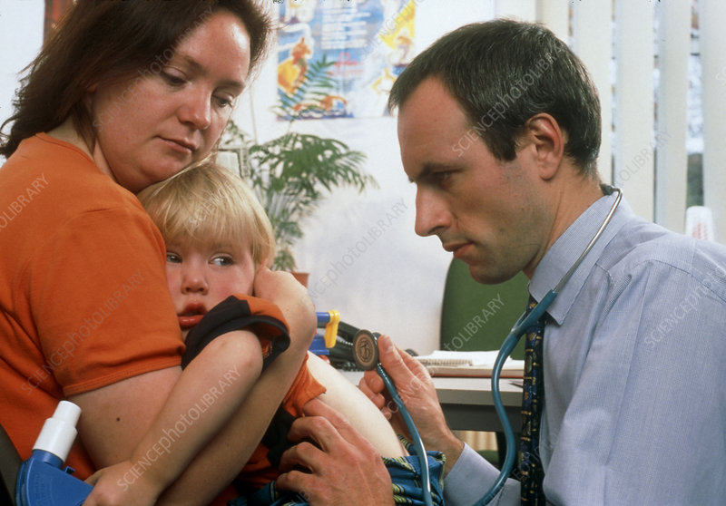 GP doctor examines child's chest with stethoscope