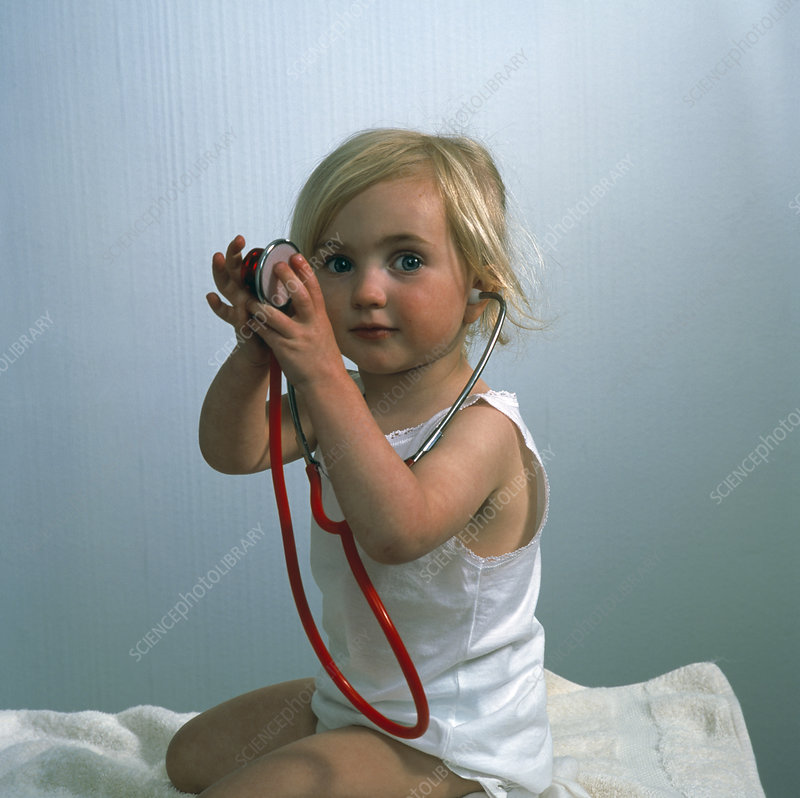 Girl playing with a stethoscope