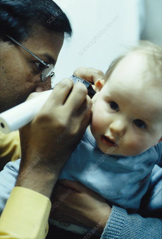 Otoscopy exam - Stock Image - M825/0772 - Science Photo Library