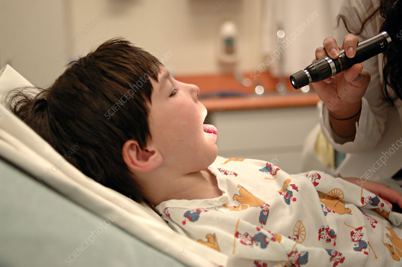 Boy Having Tonsils Examined