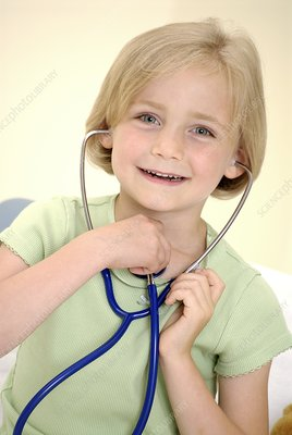 Girl using a stethoscope