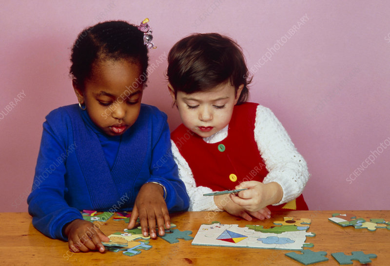 Young children playing with jigsaws