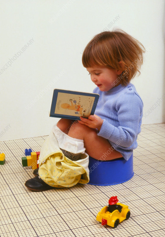 Pot training: young child sitting on a pot