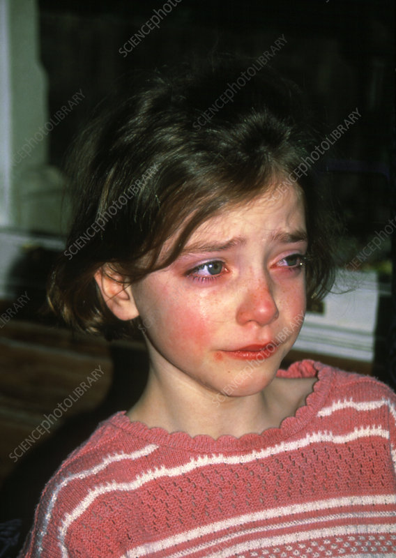 An eight year old girl crying