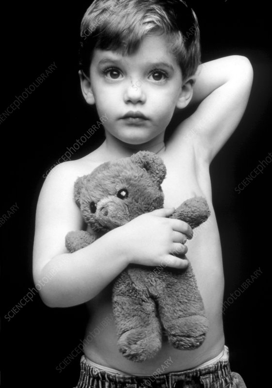 Three-year-old boy with his teddy bear toy