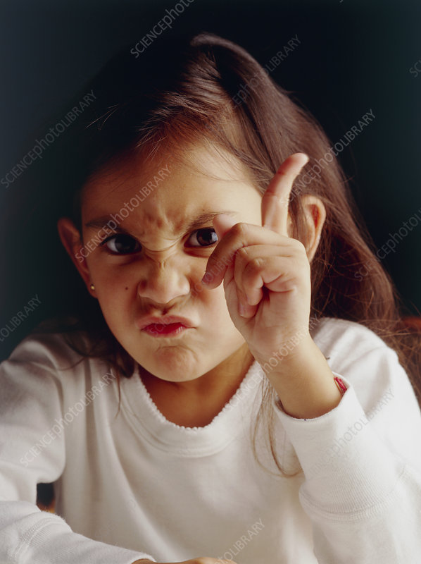 Young girl with an aggressive and angry expression
