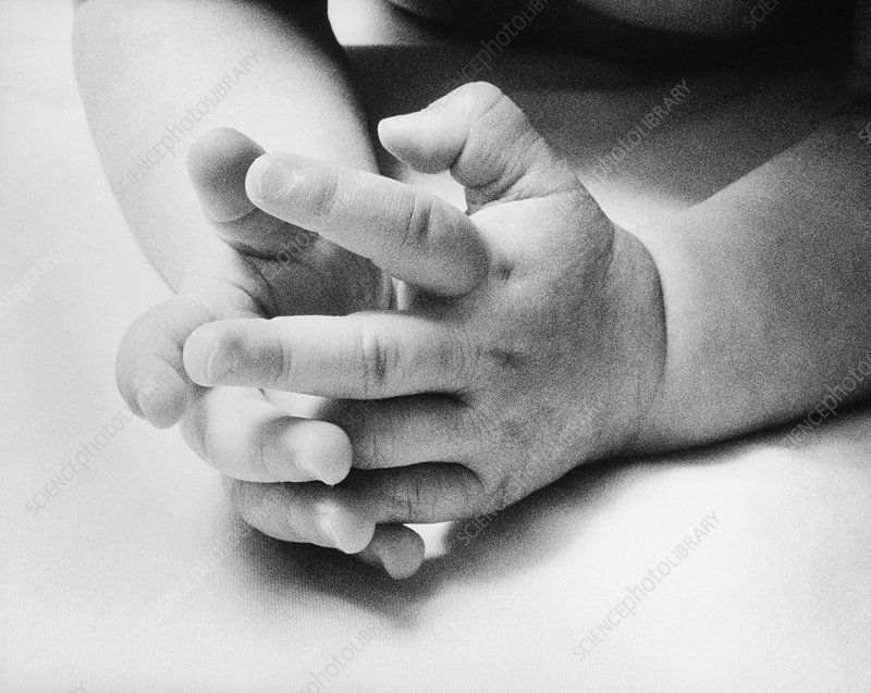 View of the hands of a nine month old baby girl