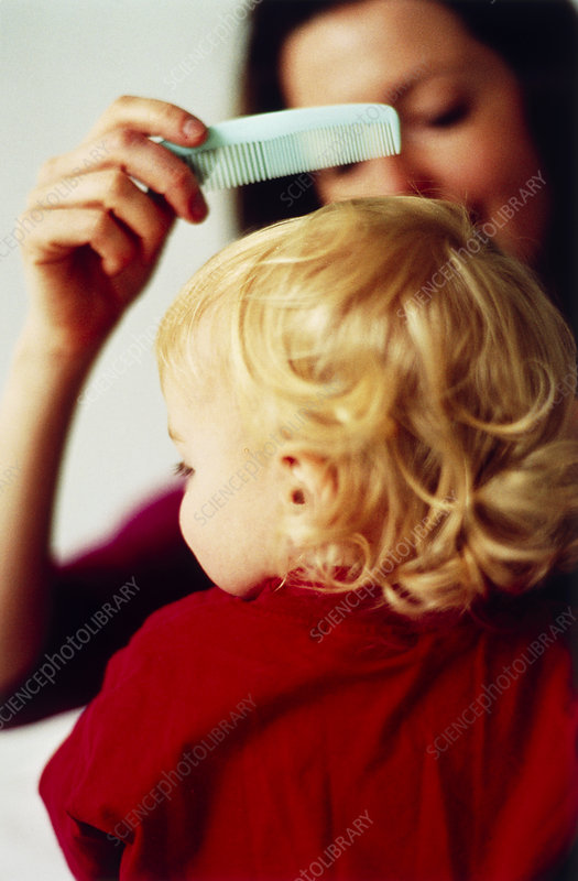Combing child's hair