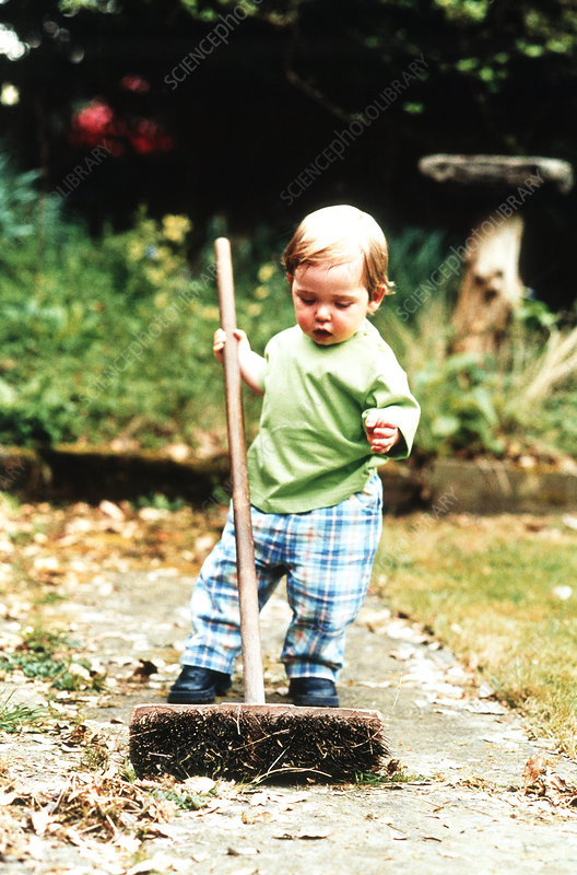 Boy using broom