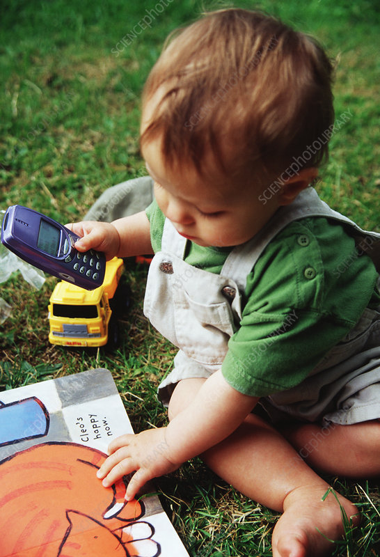 Baby playing with mobile phone