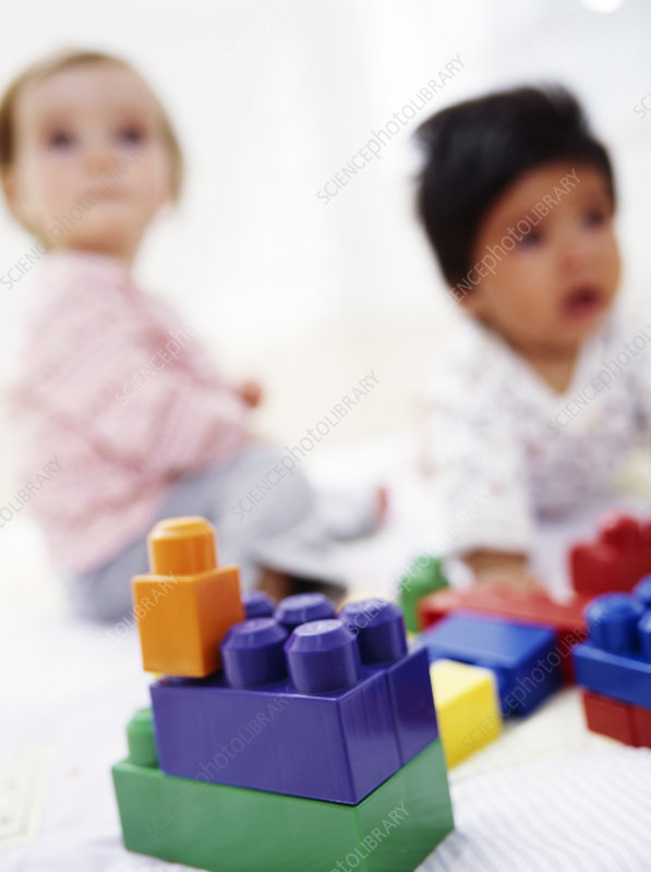 Babies with building blocks