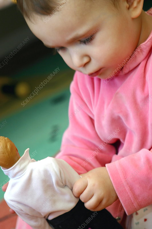 Young girl playing with a doll