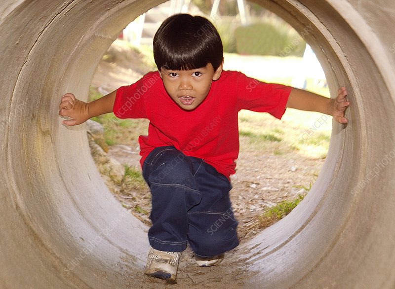 Asian boy in playground